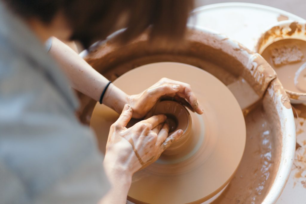 Engage yourself in things that you love doing. Photo by Juliet Furst on Unsplash. Person making pot.